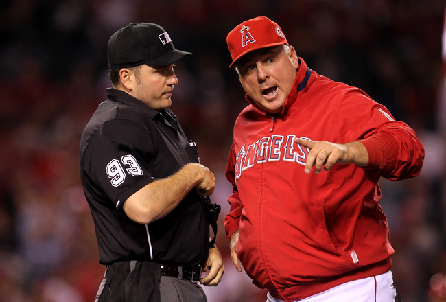 ANAHEIM, CA - MAY 11:  Manager Mike Scioscia of the Los Angeles Angels of Anaheim argues with home plate umpire Dan Bellino during the game with the Chicago White Sox on May 11, 2011 at Angel Stadium in Anaheim, California.   (Photo by Stephen Dunn/Getty