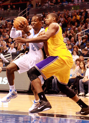 ORLANDO, FL - FEBRUARY 13:  Dwight Howard #12 of the Orlando Magic drives against Andrew Bynum #17 of the Los Angeles Lakers during the game at Amway Arena on February 13, 2011 in Orlando, Florida.  NOTE TO USER: User expressly acknowledges and agrees tha