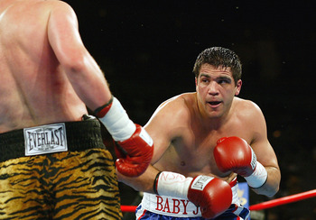 LAS VEGAS - MARCH 13:  Joe Mesi (right) battles Vassiliy Jirov during the heavyweight bout at Mandalay Bay Resort & Casino on March 13, 2004 in Las Vegas, Nevada. Mesi defeated Jirov by unanimous decision. (Photo by Jed Jacobsohn/Getty Images)