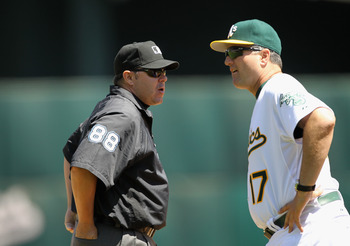 OAKLAND, CA - MAY 02:  Manger Bob Geren of the Oakland Athletics argues a call with thrid base umpire Doug Eddings during their game against the Texas Rangers at Oakland-Alameda County Coliseum on May 2, 2011 in Oakland, California.  (Photo by Ezra Shaw/G
