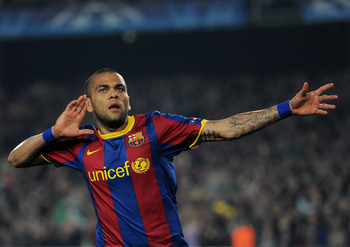 BARCELONA, SPAIN - APRIL 06:  Daniel Alves of Barcelona celebrates scoring his sides second goal during the UEFA Champions League quarter final first leg match between Barcelona and Shakhtar Donetsk at the Camp Nou stadium on April 6, 2011 in Barcelona, S