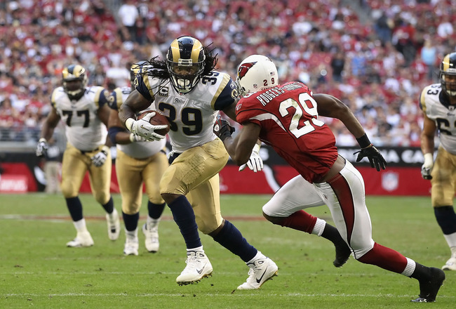 GLENDALE, AZ - DECEMBER 05:  Runningback Steven Jackson #8 of the St. Louis Rams rushes the football against Dominique Rodgers-Cromartie #29 of the Arizona Cardinals during the NFL game at the University of Phoenix Stadium on December 5, 2010 in Glendale,