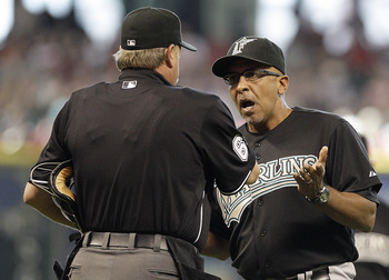 HOUSTON, TX - APRIL 10: Manager Edwin Rodriguez of the Florida Marlins argues with home plate umpire Jim Joyce after Marlins pitcher Edward Mujica # 34 was ejected from the game for hitting Bill Hall #22 of the Houston Astros with a pitch in the seventh i