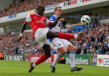 BLACKBURN, ENGLAND - AUGUST 28:  Gael Givet of Blackburn Rovers competes for the ball with Bacary Sagna of Arsenal during the Barclays Premier League match between Blackburn Rovers and Arsenal at Ewood Park on August 28, 2010 in Blackburn, England. (Photo