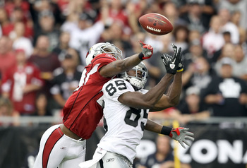 GLENDALE, AZ - SEPTEMBER 26:  Wide receiver Darrius Heyward-Bey #85 of the Oakland Raiders has the ball knocked away by Dominique Rodgers-Cromartie #29 of the Arizona Cardinals during the thrid quarter of the NFL game at the University of Phoenix Stadium