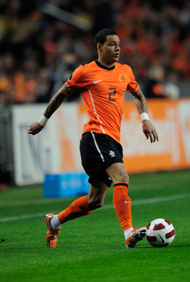 AMSTERDAM, NETHERLANDS - MARCH 29:  Gregory van der Wiel of the Netherlands in action during the Group E, EURO 2012 Qualifier between Netherlands and Hungary at the Amsterdam Arena on March 29, 2011 in Amsterdam, Netherlands.  (Photo by Jamie McDonald/Get