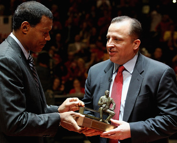 CHICAGO, IL - MAY 02: NBA executive Stu Jackson (L) gives the NBA Coach of the Year trophy to Tom Thibodeau of the Chicago Bulls before Game One of the Eastern Conference Semifinals in the 2011 NBA Playoffs against the Atlanta Hawks at the United Center o
