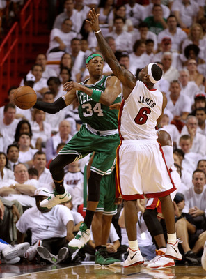 MIAMI, FL - MAY 01:  Paul Pierce #34 of the Boston Celtics passes around LeBron James #6 of the Miami Heat during game one of the Eastern Conference Semifinals of the 2011 NBA Playoffs at American Airlines Arena on May 1, 2011 in Miami, Florida. NOTE TO U