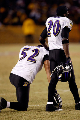PITTSBURGH - JANUARY 18:  (L-R) Ray Lewis #52 and Ed Reed #20 of  the Baltimore Ravens look on as teammate Willis McGahee is attended to by medical personnel after McGahee was hit hard by Ryan Clark #25 of the Pittsburgh Steelers during the AFC Championsh