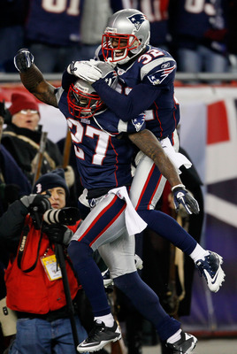 FOXBORO, MA - DECEMBER 19:  Cornerback Kyle Arrington #27 of the New England Patriots (R) is congratulated for scoring a touchdown after intercepting the ball and running 36 yards by teammate cornerback Devin McCourty #32 during the third quarter of the g