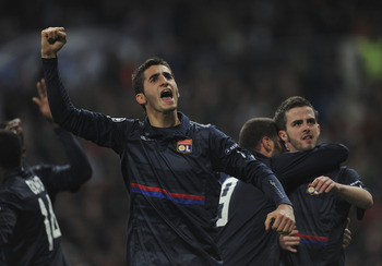 MADRID, SPAIN - MARCH 10:  Maxime Gonalons of Olympique Lyonnais celebrates after Lyonnais' scored their first goal during the UEFA Champions League round of 16 2nd leg match between  Real Madrid and Olympique Lyonnais at Estadio Santiago Bernabeu on Marc