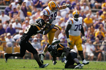 BATON ROUGE, LA - AUGUST 30:  Richard Dickson #18 of the Louisiana State University Tigers jumps over Justin Johnson #55 of the Appalachian State Mountaineers on August 30, 2008 at Tiger Stadium in Baton Rouge, Louisiana.  (Photo by Chris Graythen/Getty I