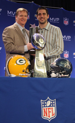 DALLAS, TX - FEBRUARY 07:  NFL Commissioner Roger Goodell (L) and Green Bay Packers quarterback Aaron Rodgers (R) pose with the MVP trophy after speaking to the media during a press conference at Super Bowl XLV Media Center on February 7, 2011 in Dallas,