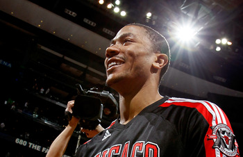 ATLANTA, GA - MAY 12:  Derrick Rose #1 of the Chicago Bulls reacts after their 93-73 win over the Atlanta Hawks in Game Six of the Eastern Conference Semifinals in the 2011 NBA Playoffs at Phillips Arena on May 12, 2011 in Atlanta, Georgia.  NOTE TO USER: