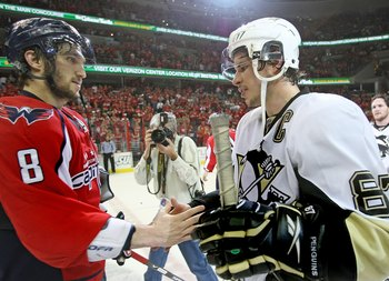 WASHINGTON - MAY 13:  Alex Ovechkin #8 of the Washington Capitals and Sidney Crosby #87 of the Pittsburgh Penguins shake hands after Pittsburgh's 6-2 victory in Game Seven of the Eastern Conference Semifinal  Round of the 2009 Stanley Cup Playoffs at Veri