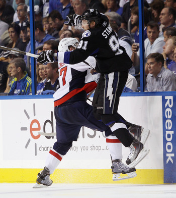 TAMPA, FL - MAY 04: Steven Stamkos #91 of the Tampa Bay Lightning is hit by Karl Alzner #27 of the Washington Capitals in Game Four of the Eastern Conference Semifinals during the 2011 NHL Stanley Cup Playoffs at the St Pete Times Forum on May 4, 2011 in