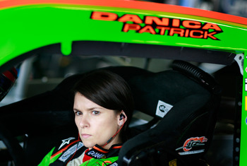DAYTONA BEACH, FL - FEBRUARY 16:  Danica Patrick, driver of the #7 GoDaddy.com Chevrolet, sits in her car in the garage area during practice for the NASCAR Nationwide Series DRIVE4COPD 300 at Daytona International Speedway on February 16, 2011 in Daytona