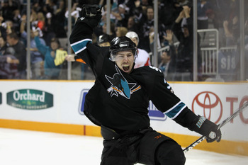 SAN JOSE, CA - MAY 08:  Logan Couture #39 of the San Jose Sharks celebrates after he scored a goal to put the Sharks up 3-1 over the Detroit Red Wings in Game Five of the Western Conference Semifinals during the 2011 NHL Stanley Cup Playoffs at HP Pavilio