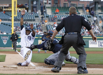 DETROIT - APRIL 26: Austin Jackson #14 of the Detroit Tigers is tagged out at home by Miguel Olivo #30 of the Seattle Mariners in the first inning at Comerica Park on April 26, 2011 in Detroit, Michigan.  (Photo by Leon Halip/Getty Images)