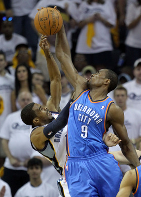 MEMPHIS, TN - MAY 07:  Serge Ibaka #9 of the Oklahoma City Thunder blocks the shot of Mike Conley #11 of the Memphis Grizzlies in Game Three of the Western Conference Semifinals in the 2011 NBA Playoffs at FedExForum on May 7, 2011 in Memphis, Tennessee.