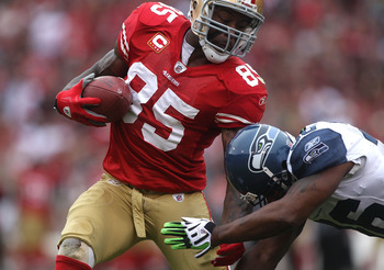 SAN FRANCISCO - DECEMBER 12:  Vernon Davis #85 of the San Francisco 49ers runs after a catch as Lawyer Milloy #36 of the Seattle Seahawks defends during an NFL game at Candlestick Park on December 12, 2010 in San Francisco, California.  (Photo by Jed Jaco