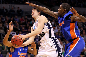 OKLAHOMA CITY - MARCH 18:  Jimmer Fredette #32 of the BYU Cougars drives for a shot attempt against Kenny Boynton #1 (R) of the Florida Gators during the first round of the 2010 NCAA men's basketball tournament at Ford Center on March 18, 2010 in Oklahoma