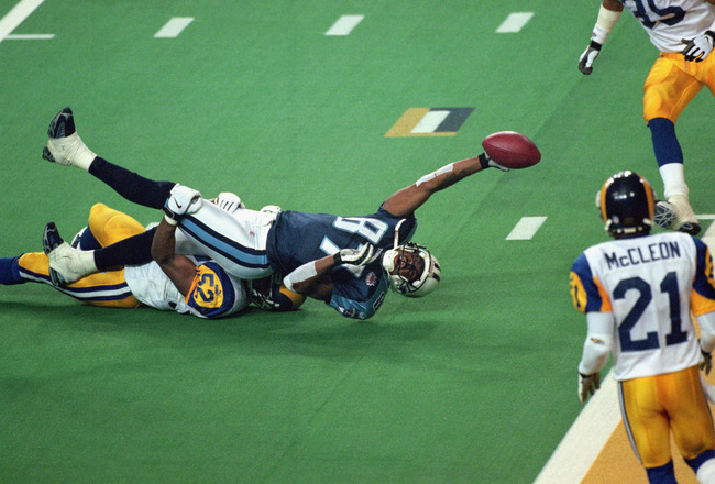 ATLANTA - JANUARY 30:  Kevin Dyson #87 of the Tennessee Titans reaches for the end zone with the ball as Mike Jones #52 of the St. Louis Rams tackles him on the last play of the game during the Super Bowl XXXIV Game at the Georgia Dome on January 30, 2000
