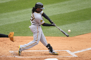 DENVER, CO - MAY 01:  Andrew McCutchen #22 of the Pittsburgh Pirates takes an at bat against the Colorado Rockies at Coors Field on May 1, 2011 in Denver, Colorado. The Pirates defeated the Rockies 8-4.  (Photo by Doug Pensinger/Getty Images)