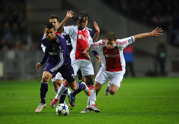 AMSTERDAM, NETHERLANDS - NOVEMBER 23: Cristiano Ronaldo of Real Madrid battles for the ball with Jan Vertonghen of Ajax during the UEFA Champions League Group G match between AFC Ajax and Real Madrid at the Ajax Arena on November 23, 2010 in Amsterdam, Ne