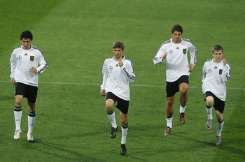 PRETORIA, SOUTH AFRICA - JULY 05:  Players of Germany exercise during a training session at Super stadium on July 5, 2010 in Pretoria, South Africa.  (Photo by Joern Pollex/Getty Images)