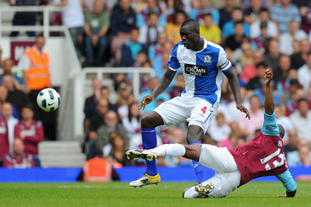 LONDON, ENGLAND - MAY 07:  Luis Boa Morte of West Ham United tackles Christopher Samba of Blackburn Rovers during the Barclays Premier League match between West Ham United and Blackburn Rovers at the Boleyn Ground on May 7, 2011 in London, England.  (Phot