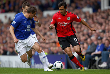 LIVERPOOL, ENGLAND - APRIL 16:  Roque Santa Cruz of Blackburn Rovers attempts to move away from Diniyar Bilyaletdinov and Phil Jagielka of Everton during the Barclays Premier League match between Everton and Blackburn Rovers at  Goodison Park on April 16,