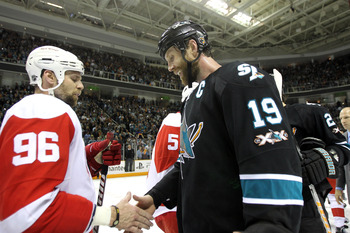 SAN JOSE, CA - MAY 12:  Joe Thornton #19 of the San Jose Sharks shakes hands with Tomas Holmstrom #96 of the Detroit Red Wings after the Sharks won Game Seven of the Western Conference Semifinals during the 2011 NHL Stanley Cup Playoffs at HP Pavilion on