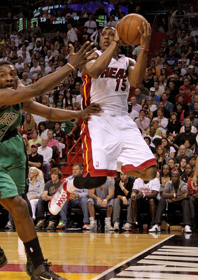 MIAMI, FL - APRIL 10:  Mario Chalmers #15 of the Miami Heat looks to pass during a game against the Boston Celtics at American Airlines Arena on April 10, 2011 in Miami, Florida. NOTE TO USER: User expressly acknowledges and agrees that, by downloading an