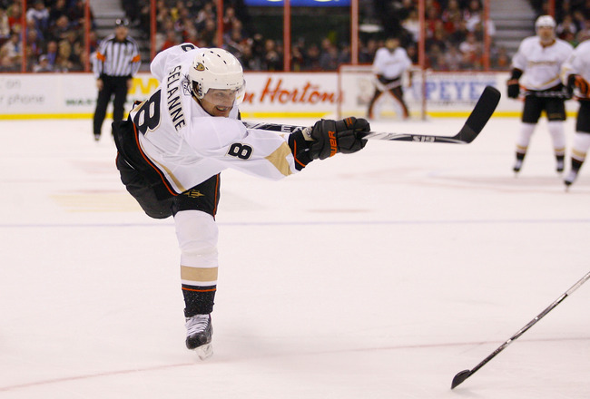 OTTAWA, ON - JANUARY 18:  Teemu Selanne #8 of the Anaheim Ducks fires a hard slapshot off the post in a game against the Ottawa Senators at Scotiabank Place on January 18, 2011 in Ottawa, Canada.  (Photo by Phillip MacCallum/Getty Images)