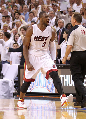 MIAMI, FL - MAY 11:  Dwyane Wade #3 of the Miami Heat reacts after taking the lead during Game Five of the Eastern Conference Semifinals of the 2011 NBA Playoffs against the Boston Celtics at American Airlines Arena on May 11, 2011 in Miami, Florida. NOTE