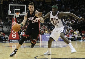 NEWARK, NJ - APRIL 03:  Mike Miller #13 of the Miami Heat drives against Anthony Morrow #22 of the New Jersey Nets at the Prudential Center on April 3, 2011 in Newark, New Jersey.NOTE TO USER: User expressly acknowledges and agrees that, by downloading an