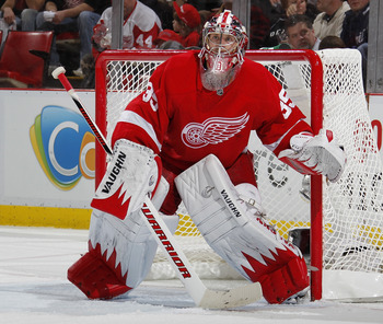DETROIT, MI - APRIL 16: Jimmy Howard #35 of the Detroit Red Wings watches the puck while playing the Phoenix Coyotes in Game Two of the Western Conference Quarterfinals during the 2011 Stanley Cup Playoffs at Joe Louis Arena on April 16, 2011 in Detroit,