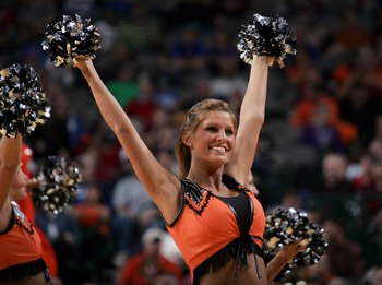 DALLAS - MARCH 10:  A cheerleader of the Oklahoma State Cowboys entertains fans during a break in game action against the Kansas Jayhawks during the quarterfinals round of the Phillips 66 Big 12 Men's Basketball Championship Tournament at American Airline