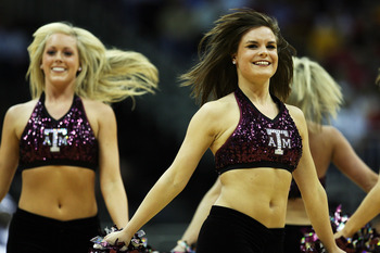 KANSAS CITY, MO - MARCH 13:  The Texas A&M Aggies cheerleaders dance during a timeout in the game against the Iowa State Cyclones on day 1 of the Big 12 Men's Basketball Tournament on March 13, 2008 at the Sprint Center in Kansas City, Missouri.  (Photo b