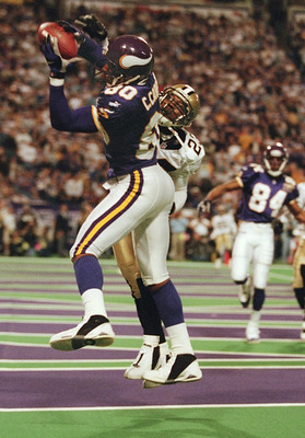 06 Jan 2001:  Wide receiver Cris Carter #80 of the Minnesota Vikings pulls down a catch for a touchdown over the reach of cornerback Kevin Mathis #23 of the New Orleans Saints at the Metrodome in Minneapolis, Minnesota.   The Vikings won 34-16 to advance