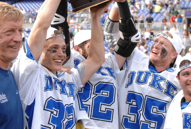 BALTIMORE, MD - MAY 31:  Head coach John Danowski, Sam Payton #32, Ned Crotty #22, Parker McKee #35, and Max Quinzani #9 of the Duke Blue Devils celebrate winning the 2010 NCAA Division 1 Lacrosse Championship against the Notre Dame Fighting Irish on May