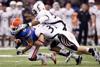 NEW ORLEANS - JANUARY 01:  Deonte Thompson #6 of the Florida Gators gets tackled by J.K. Schaffer #37 of the Cincinnati Bearcats during the Allstate Sugar Bowl at the Louisana Superdome on January 1, 2010 in New Orleans, Louisiana.  (Photo by Kevin C. Cox