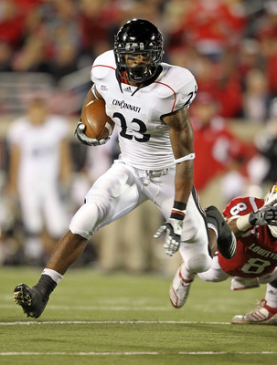 LOUISVILLE, KY - OCTOBER 15: Isaiah Pead #23 of the Cincinnati Bearcats runs with the ball during the Big East Conference game against the Louisville Cardinals at Papa John's Cardinal Stadium on October 15, 2010 in Louisville, Kentucky.  (Photo by Andy Ly