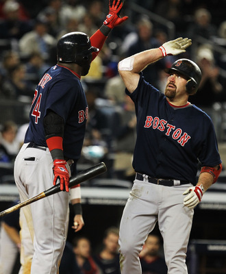 NEW YORK, NY - MAY 13:  Kevin Youkilis #20 of the Boston Red Sox is met by David Ortiz #34 after hitting a two run home run against the New York Yankees during their game on May 13, 2011 at Yankee Stadium in the Bronx borough of New York City.  (Photo by