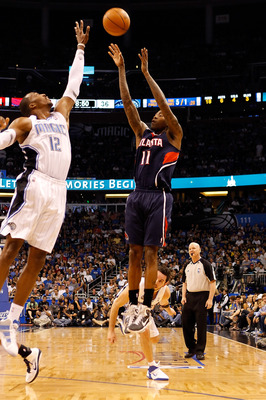 ORLANDO, FL - APRIL 26:  Jamal Crawford #11 of the Atlanta Hawks shoots over Dwight Howard #12 of the Orlando Magic during Game Five of the Eastern Conference Quarterfinals of the 2011 NBA Playoffs on April 26, 2011 at the Amway Arena in Orlando, Florida.