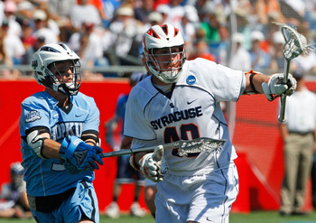 FOXBORO, MA - MAY 26:  Danny Brennan #40 of the Syracuse Orange battles Michael Evan #33 of the Johns Hopkins Blue Jays during the NCAA Lacrosse Championship at Gillette Stadium on May 26, 2008 in Foxboro, Massachusetts. Syracuse captured a 13-10 victory.