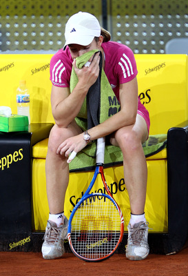 MADRID, SPAIN - MAY 09:  Justin Henin of Belgium  shows her dejection against Aravane Rezai of France in their first round match during the Mutua Madrilena Madrid Open tennis tournament at the Caja Magica on May 9, 2010 in Madrid, Spain.  (Photo by Clive