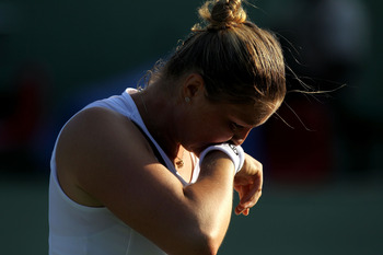 KEY BISCAYNE, FL - MARCH 25:  Dinara Safina of Russia wipes sweat off of her face against Vera Zvonareva of Russia during the Sony Ericsson Open at Crandon Park Tennis Center on March 25, 2011 in Key Biscayne, Florida.  (Photo by Al Bello/Getty Images)
