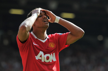 MANCHESTER, ENGLAND - APRIL 09:  Nani of Manchester United holds his head during the Barclays Premier League match between Manchester United and Fulham at Old Trafford on April 9, 2011 in Manchester, England.  (Photo by Michael Regan/Getty Images)